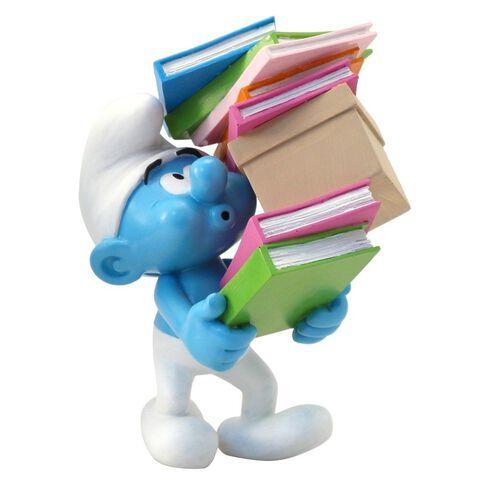 Figurine - Schtroumpf portant une pile de livres